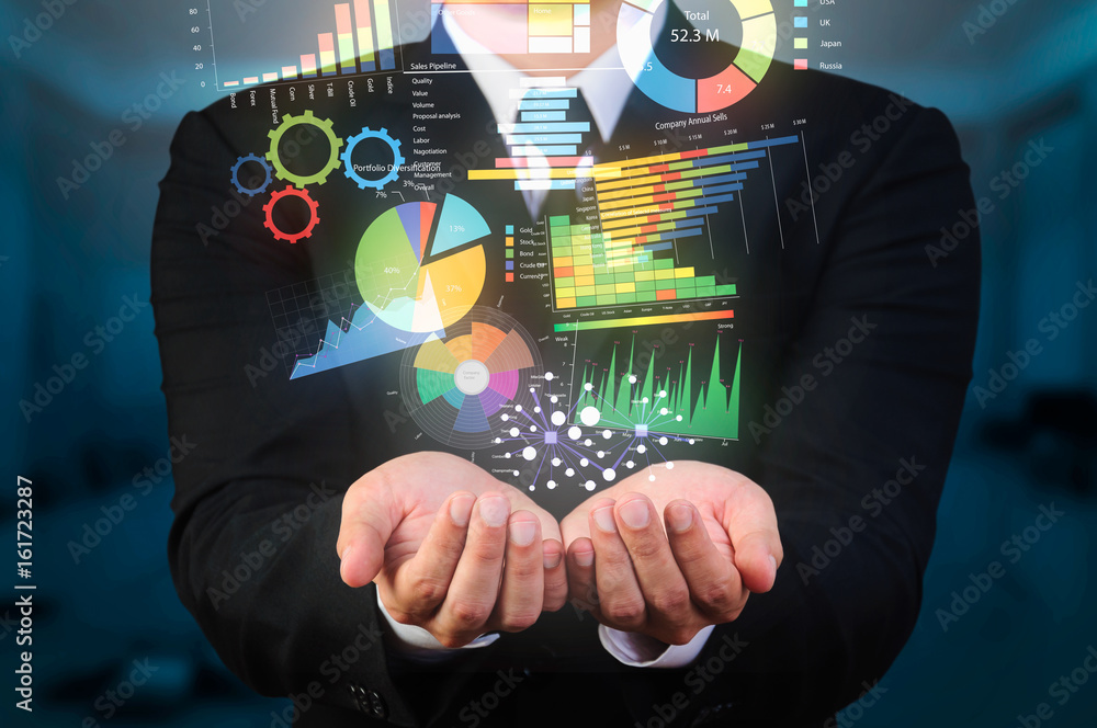 Fototapeta businessman holding data visualization
