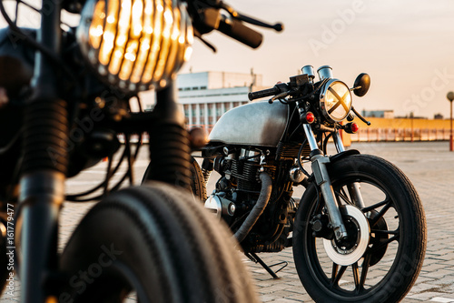 Fotomural Vintage custom motorcycle cafe racer motorbike with lamp lights turned on