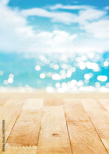 Wood table top on blur summer beach and sunny sky background