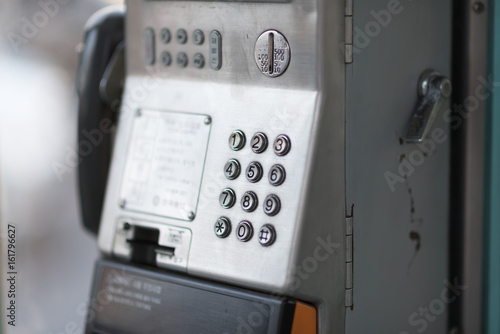 old pay telephone on a city street  Silver color phone - Buy