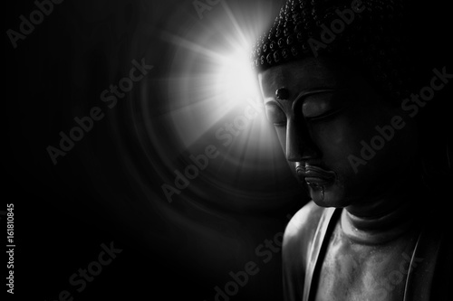 zen style buddha with light of wisdom black and white, peacful asian buddha tao religion art style statue.