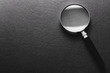 magnifying glass on  black texture  background.