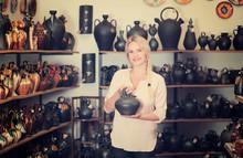 Woman In Crockery Shop Choosin...