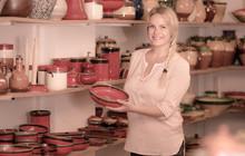 Merry Female Customer Picking Red Glazed Crockery