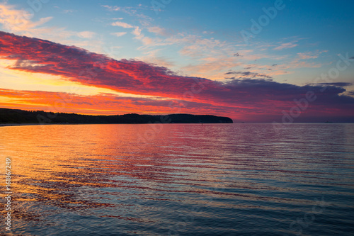 Foto op Plexiglas Crimson Red sunset over the sea