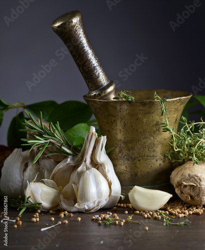 Photo  Different herbs and spices on a wooden table .
