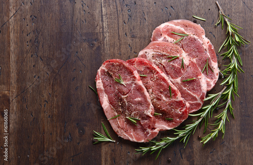 Obraz na plátně  Pork steak with rosemary and pepper , free space for your text