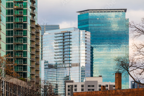 Fotografía  Group of skyscrapers with glass facades in Midtown Atlanta in cloudy day, USA