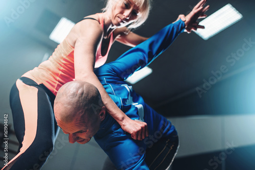 Photo Stands Martial arts Male and female fighters, self-defense technique