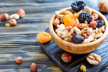 Nuts And Dried Fruit In A Wood...