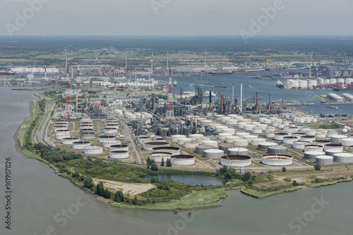 Foto op Plexiglas Antwerpen Aerial view on the east side of Port of Antwerp with Total Antwerp oil tanks in the foreground