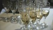 A lot of glasses with sparkling wine on table during the party. Close-up
