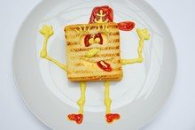 Sandwich In The Form Of Sponge Bob With Cheese, Ham And Ketchup On A White Background