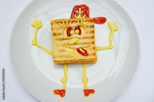 Sandwich in the form of Sponge Bob with cheese, ham and ketchup on a white backg Wallpaper Mural