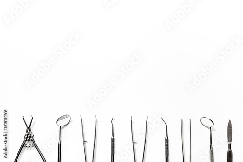 Fototapeta teeth care with dentist instruments in doctor's office white background top view mock-up obraz na płótnie