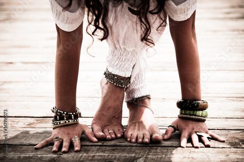 Staande foto School de yoga closeup of barefoot woman feet and hands practice yoga