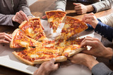 Group Of Businesspeople Eating Pizza - 161921601