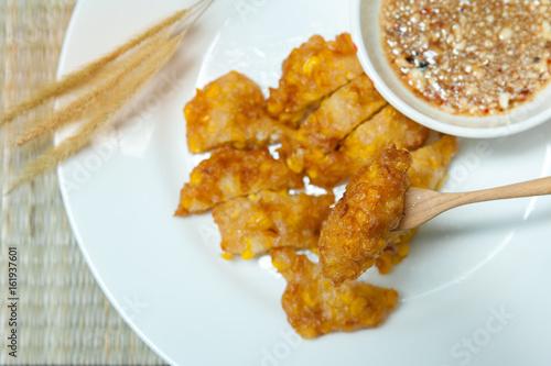 Foto op Aluminium Kip Sweet Corn Fritters,Crispy fried corn in a white plate on bamboo mat -table,Snacks Thai style.