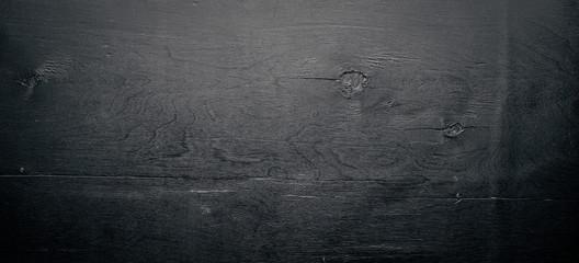 Drewniane strukturalne czarne tło. Widok z góry. Wolna przestrzeń.