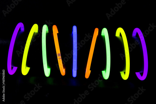Fotografie, Obraz  Bracelets made with glow sticks fluorescent lights