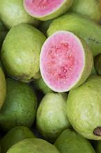 Fresh Ripe Guava Fruit Cut Open To Display The Pink Flesh At A Farmers Market In Rio De Janeiro, Brazil