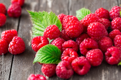 raspberry. Juice summer fruits with leaves.