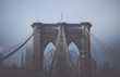 Foggy cloudy rainy day on Brooklyn Bridge. NYC