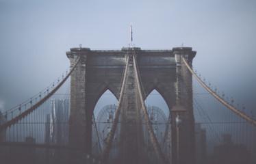 Foggy cloudy rainy day on Brooklyn Bridge. NYC