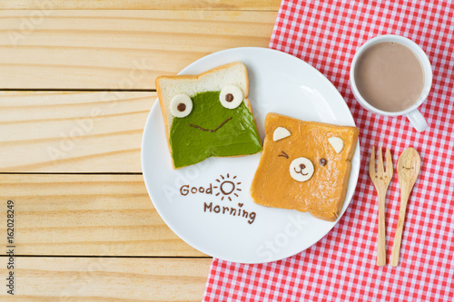 Top View Of Cute Breakfast For Kids Green Tea Spread And Peanut Butter Design To Frog