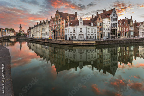 Wall Murals Bridges Scenic cityscape with canal Spiegelrei and Jan Van Eyck Square in the morning in Bruges, Belgium