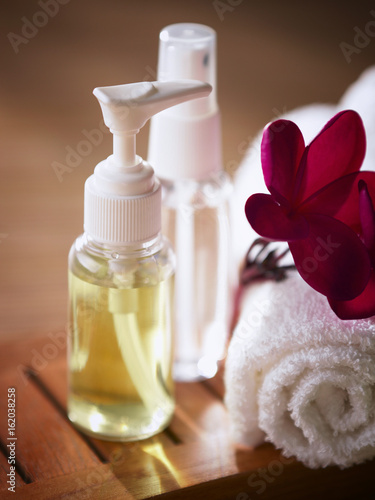 Fotografie, Obraz  cosmetic bottles with towel and flower