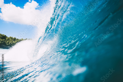 Stickers pour portes Eau Blue wave in ocean. Clear wave and blue sky