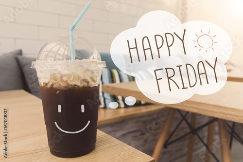 Poster  Happy Friday ice coffee drink in coffee shop background with vintage filter
