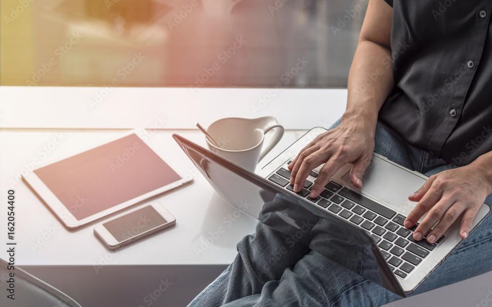 Fototapeta Digital lifestyle blog writer or business freelancer person using smart device working on internet communication technology