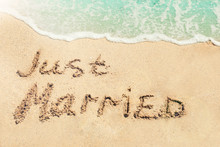 Text JUST MARRIED Written On S...
