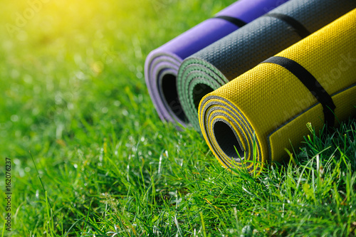 Obraz Gymnastic mats on the grass - fototapety do salonu
