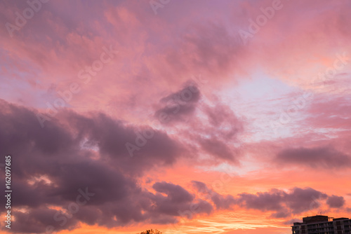 Poster Corail A dramatic sunset cloud formation with vibrant colors across the sky at summer time in Houston, Texas, America. Nature in twilight period, beautiful landscape background.