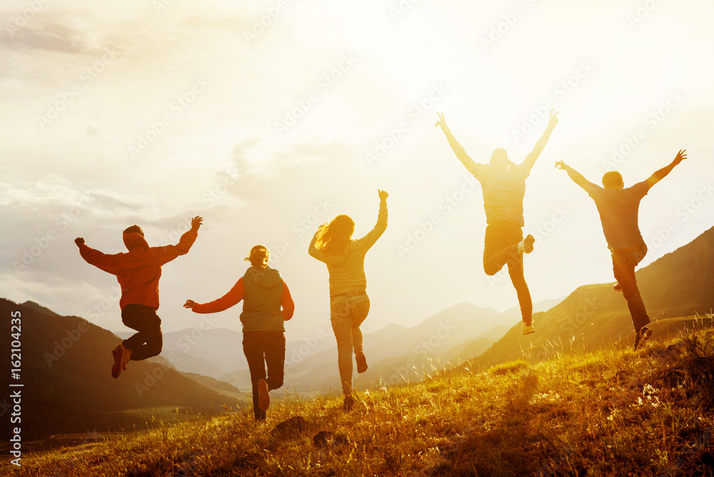 Fototapety, obrazy: Group of happy friends run and jump