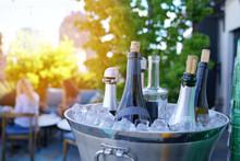 Wine Bottles Set In Bucket, NY...