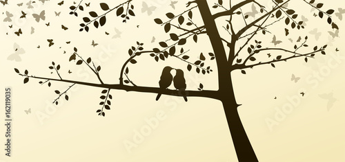 Photo Enamored Birds Sitting on a Tree in a Romantic Setting
