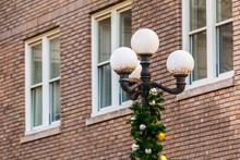 A Streetlight With Christmas D...