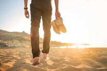 Man Walking In The Beach, He I...