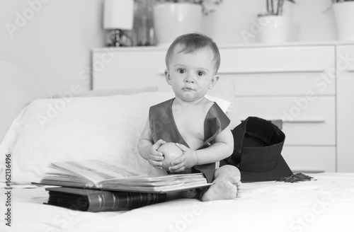 Black And White Image Of Funny Baby With Graduation Cap And Ribbon