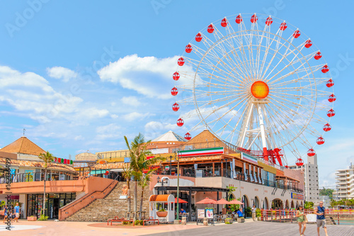 Poster Attraction parc American Village with a huge ferris wheel under the clear sky on June 2, 2013 in Okinawa, Japan.