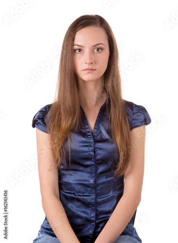 Obraz na plátne  Head and torso of a brown hair lady.
