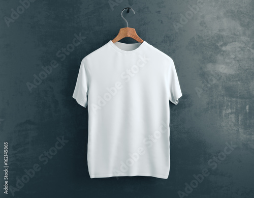 White t-shirt on concrete background