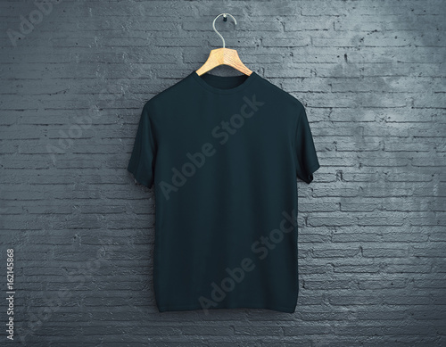 Black t-shirt on brick background