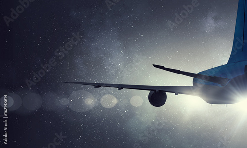 Airliner in night sky Canvas Print
