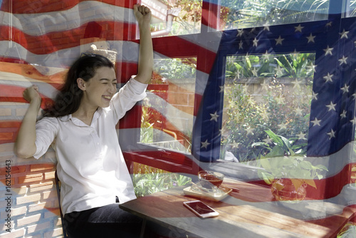 82cb582a7d Patriotic composite of happy young half Thai-American woman in happy moment  over background of