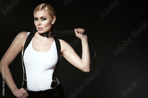 685028bbb37a10 Portrait of chic blond model with pulled back hair and smoky eye make-up  wearing